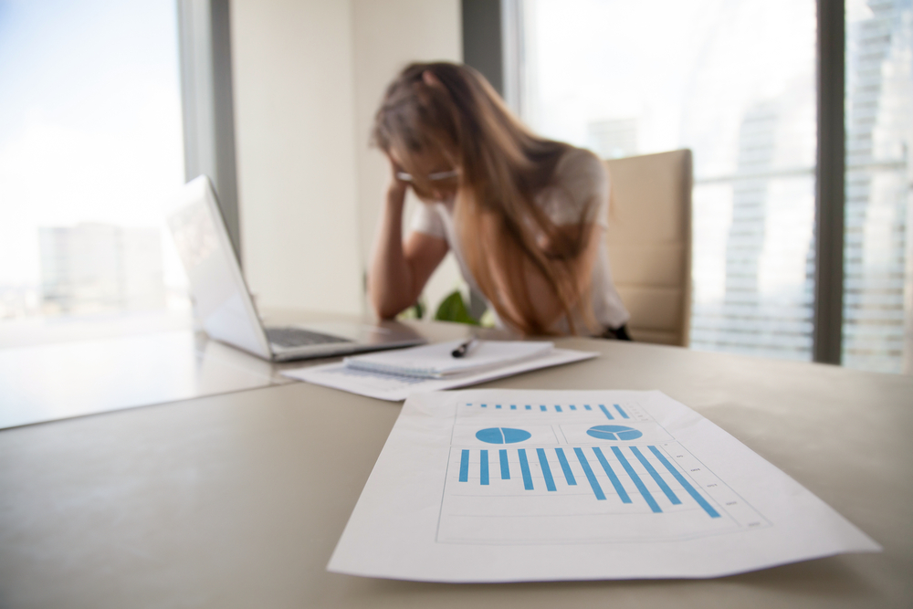 featured image of a A Depressed frustrated businesswoman shocked by financial problems