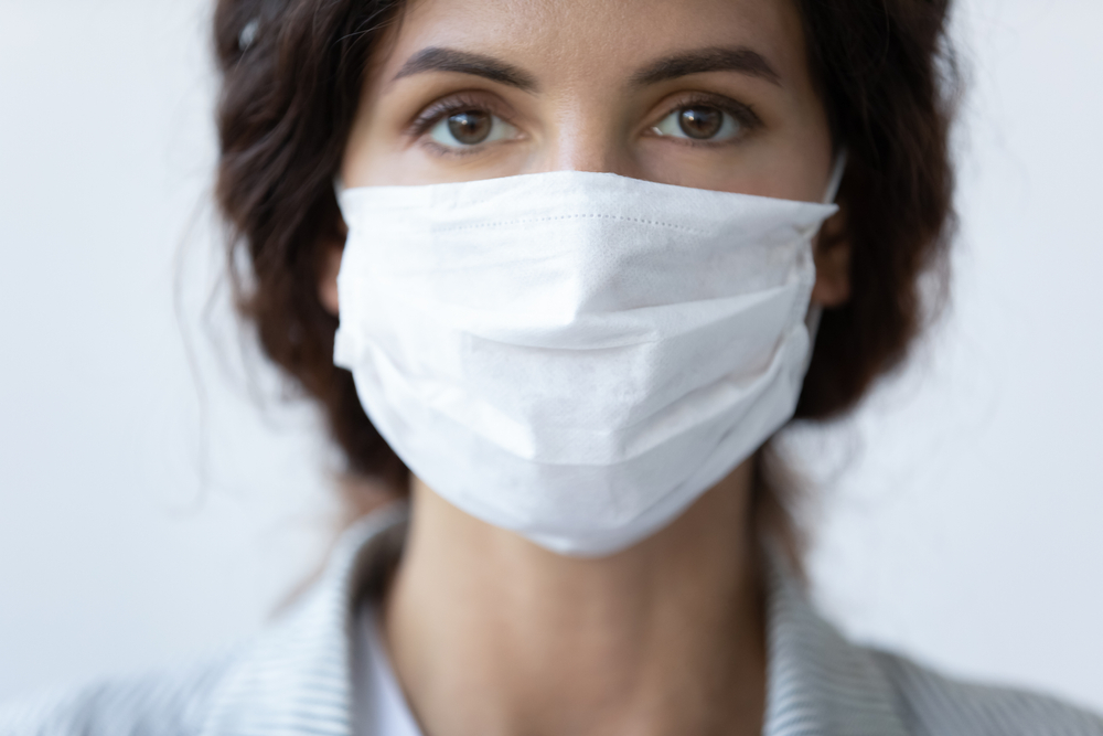 featured image showing a woman wearing a face mask
