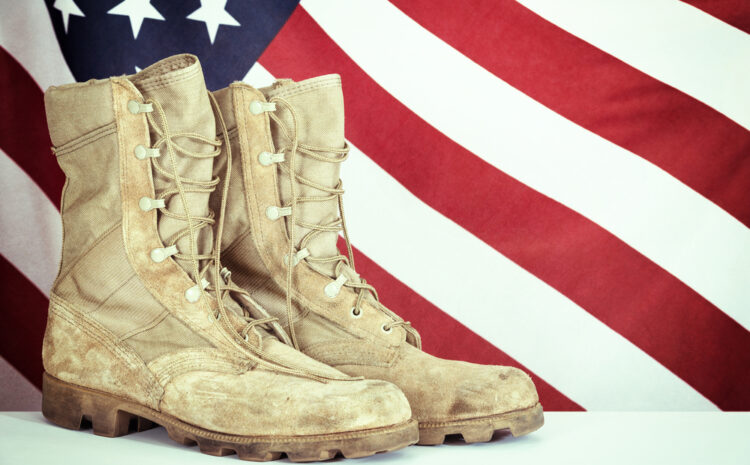 Featured image showing Old combat boots with American flag in the background.
