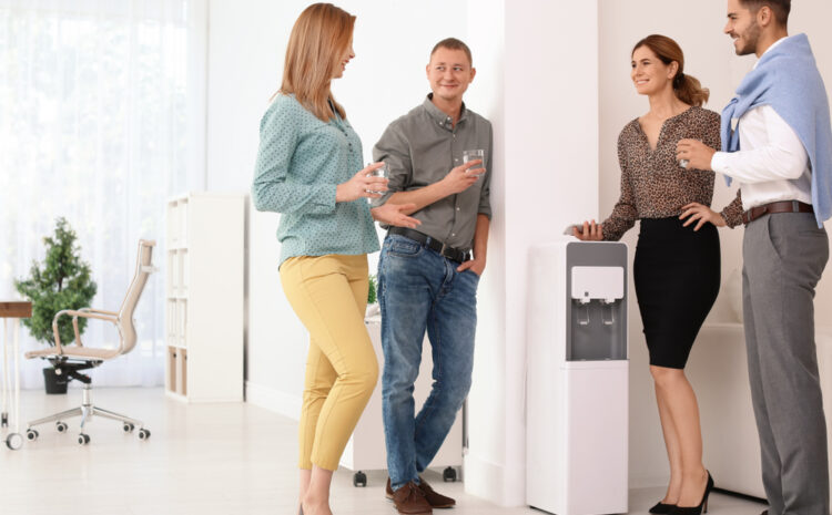 featured image showing Co-workers having break near water cooler at workplace