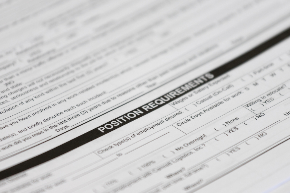 featured image showing Closeup of a job application with the words Position Requirements as the focal point.