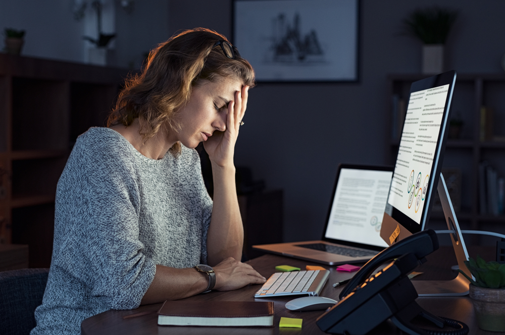 featured image showing a business woman working from home after hours