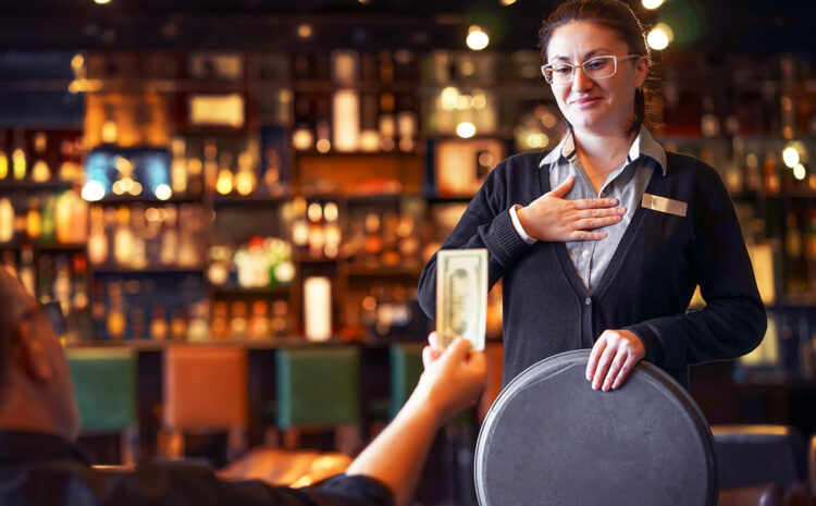 Featured image showing a food service worker taking a tip.